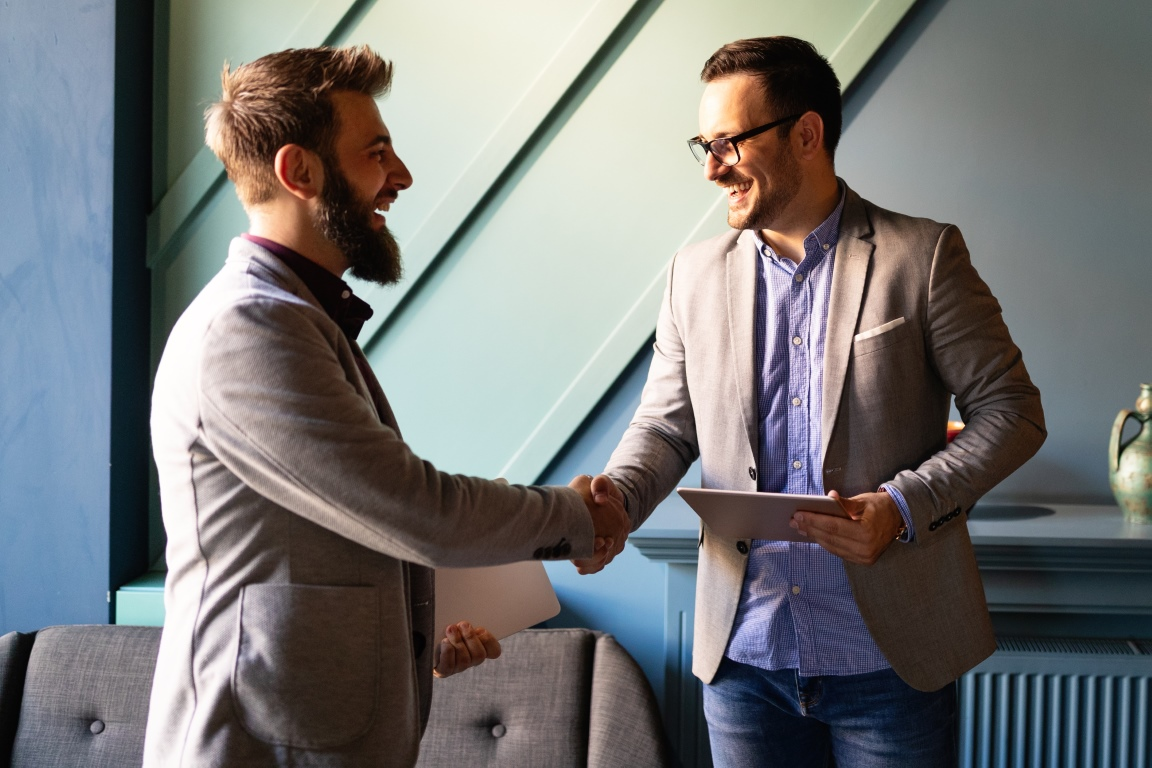 Business handshake and successful business people concept. Partnership, deal, agreement.